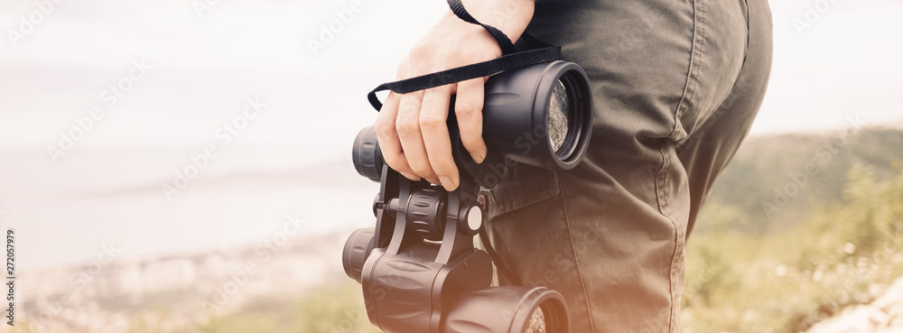 Fototapety, obrazy: Unrecognizable woman with binoculars outdoor.