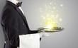 Leinwandbild Motiv Elegant young waiter serving mysterious light on tray