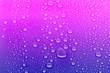 Leinwandbild Motiv Neon colored water drops background