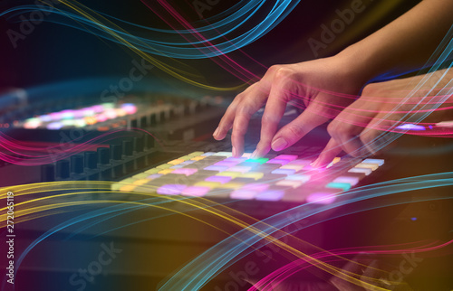 Hand mixing music on midi controller with colorful vibe concept  - 272065119