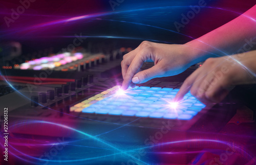 Hand mixing music on midi controller with wave vibe concept  - 272065132