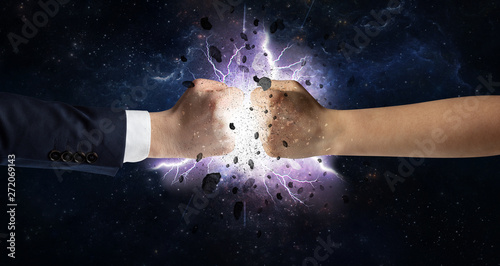 Fotografie, Tablou  Two hands fighting with storm explosion concept