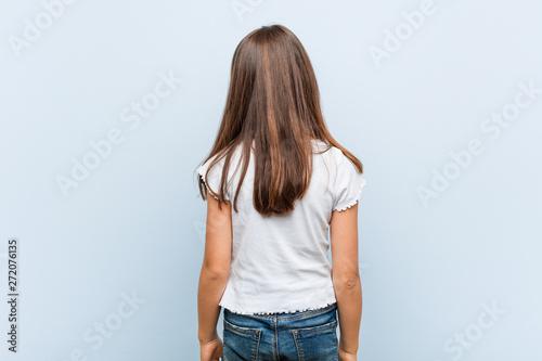 Fotomural  Cute girl from behind, looking back.