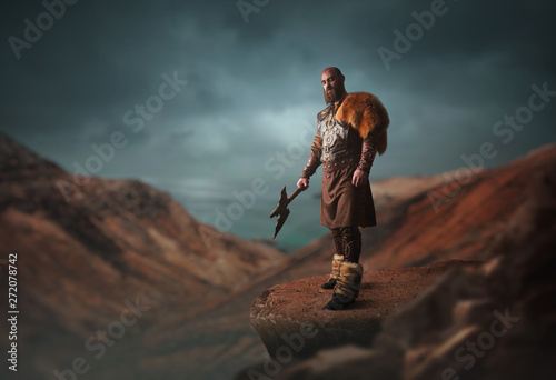 Handsome viking with axe on the top of mountain Wallpaper Mural