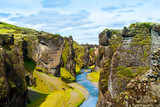 Iceland canyon fjaðrárgljúfur with river flowing through it