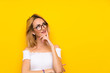 Leinwanddruck Bild - Young blonde woman over isolated yellow wall with glasses