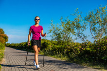 Nordic Walking - Young Woman T...
