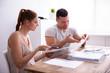 Leinwandbild Motiv Couple Arguing Over Invoice