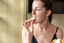 Beautiful Woman Eating Banana