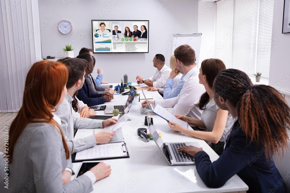 Fototapeta Businesspeople Having Video Conference In Boardroom