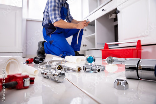 Photo sur Toile Les Textures Plumber Tools And Equipment In Kitchen