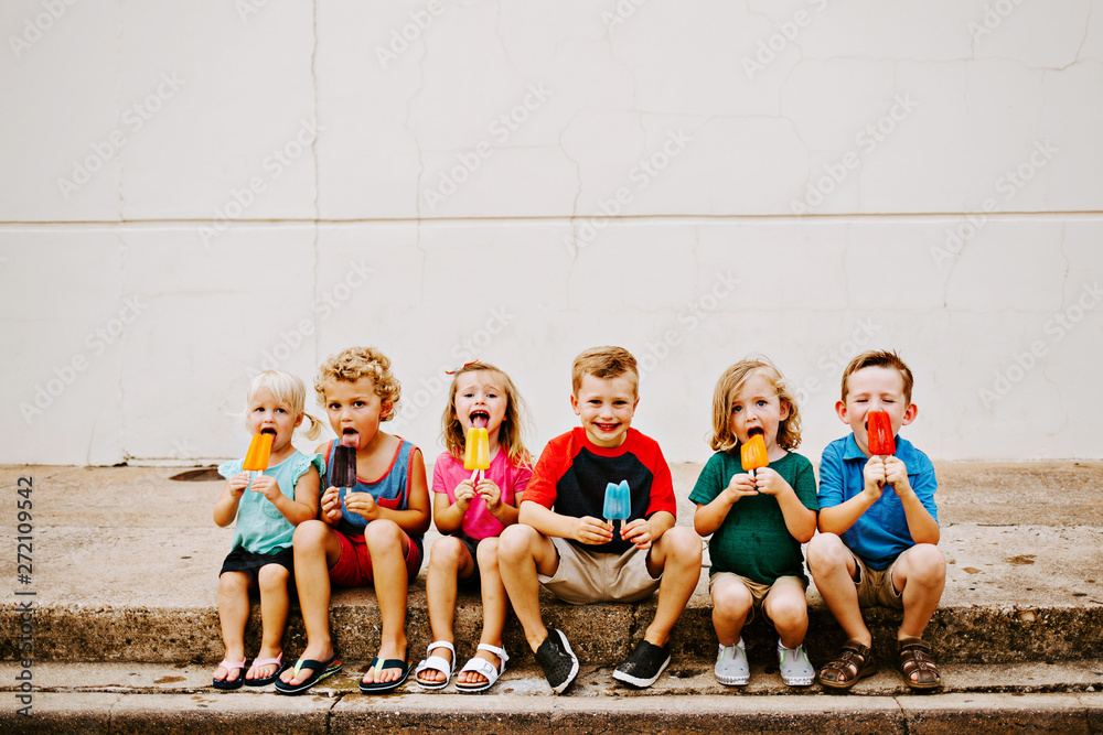 Fototapety, obrazy: Group of Kids Eating Frozen Colorful Popsicles in the Summer