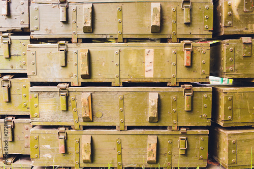 Cuadros en Lienzo Military green boxes with dangerous explosives, guns and military weaponry, ready for shipping, in a munition producing factory