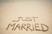 Just Married Text On Sand At B...