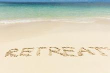 Retreat Text On Sand Near The ...