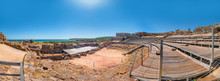Panorama View Of The Theatre In Ancient Romans Ruins Of Baelo Claudia, Next To The Beach Of Bolonia, Near Tarifa In Cadiz In The South Of Spain.