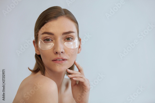 Eye skin care. Woman with beauty patch mask under eyes portrait Poster Mural XXL