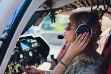 Female Pilot In Cockpit Of Hel...