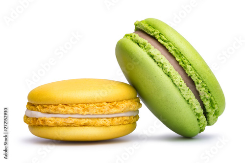 Foto auf Gartenposter Macarons Yellow and green macaron cookies isolated on white background