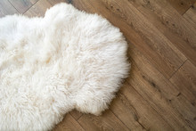 Sheep Skin On The Laminate Floor In The Room. View From Above