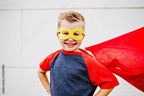 Obraz na płótnie Little boy wearing cape dressed up like a superhero