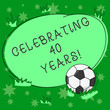 canvas print picture - Writing note showing Celebrating 40 Years. Business photo showcasing Honoring Ruby Jubilee Commemorating a special day Soccer Ball on the Grass and Blank Outlined Round Color Shape photo