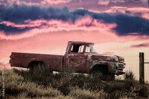 Obraz vintage pickup truck on a meadow at sunset - fototapety do salonu