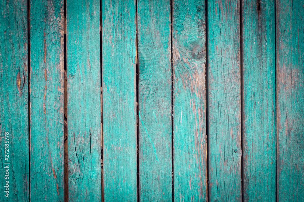 Fototapeta old shabby wooden green fence in the street