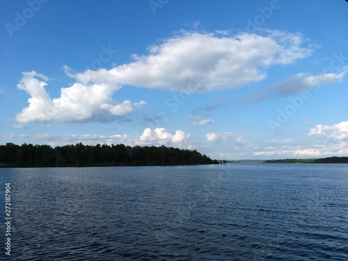 Fototapeten Forest river Cloudscape