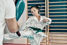 Taekwondo Instructor Working With Girl