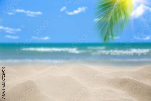 Canvas Prints Countryside Beach with blurry blue ocean and sky,palm tree background ,Summer Concept .