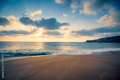Tuinposter Cappuccino Sunset over the sea. Atlantic ocean in the evening. Nazare, Portugal, Europe