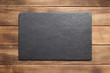 Leinwandbild Motiv slate stone sign board at wooden plank
