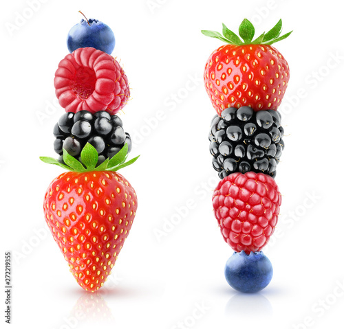 Isolated berries pyramids. Strawberry, blackberry, raspberry and blueberry on top of each other isolated on white background with clipping path