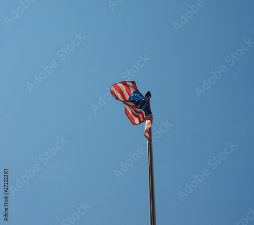 Canvastavla  American Flag of United States of America over blue sky