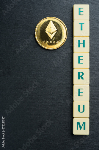 Physical Ethereum gold coin with text made out of letter