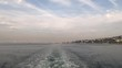 timelapse Boat with tourists swims around the coast of Istanbul with beautiful houses, leaving a trail on the water