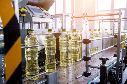 Bottling line of sunflower oil in bottles. Vegetable oil production plant. High technology.