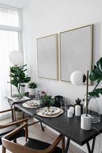 Cozy Dining Corner With Nice Decoration In Scandinavian Style With Empty Golden Frame Install On The Wall / Interior Design Decoration / Cozy Interior Concept
