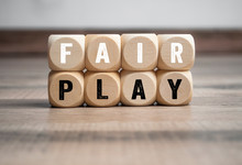 Cubes And Dice With The Word Fair Play On Wooden Background