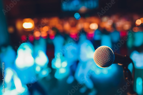 Stampa su Tela  microphone on a stand up comedy stage with colorful bokeh , high contrast image