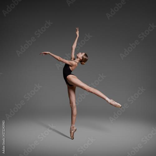 Fototapeta Beautiful flexible ballerina dancing in studio