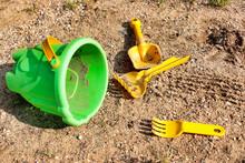 Left Children Toys On The Sand...