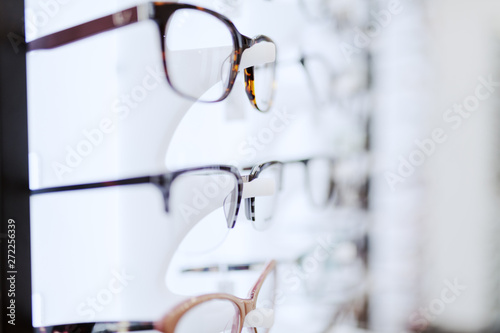 Photo  Picture of many different eyeglasses on rack.