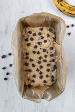 Banana Bread Mixture With Chocolate Chips In Baking Pan Flat Lay