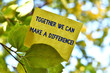 canvas print picture - Word writing text Together We Can Make A Difference. Business photo showcasing be very important some way in like team or group Piece of square paper use to give notation on tree leaf under sunny day