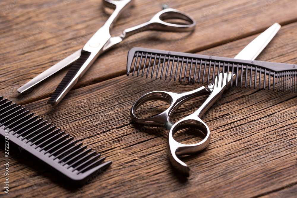 Fototapeta Barber tool. Barber scissors. Scissors and hairbrush on vintage wooden background.