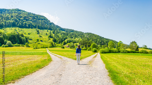Fotografie, Obraz  A choice of two ways. Woman at a crossroads.