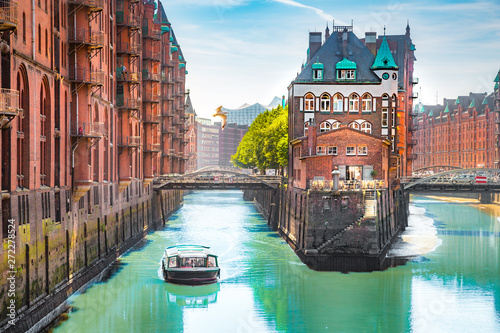 Fototapeta Hamburg Speicherstadt harbor district with tour boat in summer, Germany