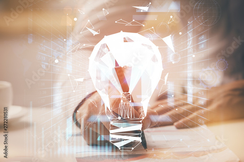 Fotografie, Obraz  View of Bulb lamp idea concept icon on a futuristic interface with writing man's hand background